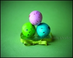 Easter eggs stacked on a ribbon!