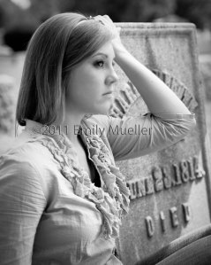 Emily poses next to an old headstone in the Athens Cemetary.